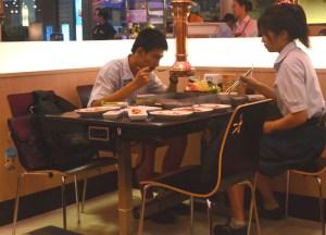 Students at Kim Ju Barbecue, Bangkok Korean Barbecues, Thailand