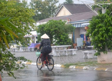Cycling Past Daosavanh Restaurant in Savannakhet, French food in Laos