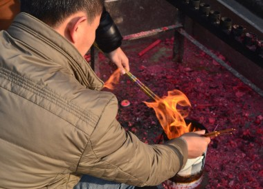 Lighting Incense Sticks, Top Attractions in Xian China (Shaanxi)