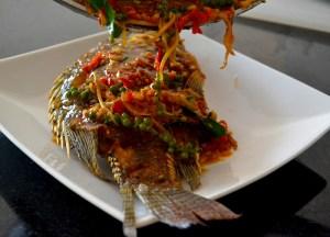 Serving Pad Cha Sauce, Thai fried fish, Thailand