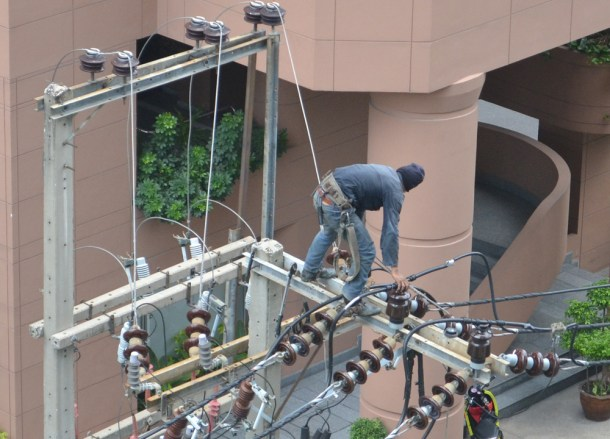 Fixing Electricity Wires, Suriving Power Outages in Bangkok