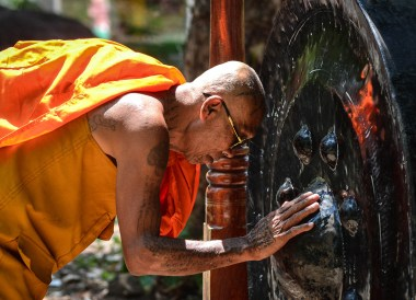 Monk at Wat Khao Angkan. Top Tourist Attractions in Buriram Thailand