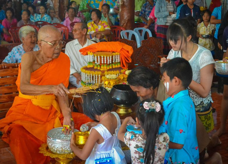Blessing from Elder Monk at Temple on Songkran Festival in Thailand