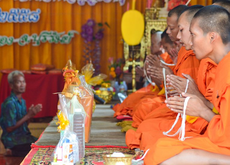 Monks Praying With Sacred Thread during New Year Songkran New Year Festival in Thailand