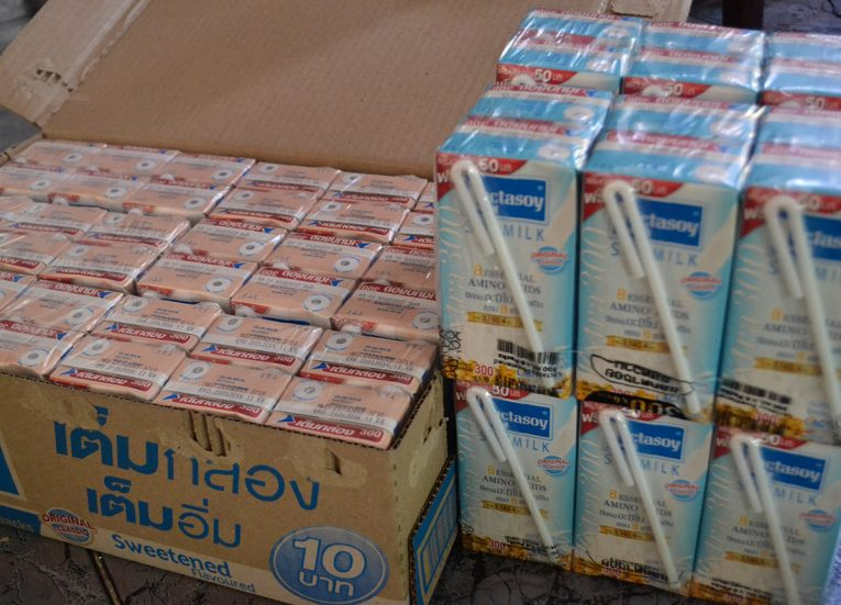 Thai Milk as Donation to Elderly and Temple Songkran New Year Festival in Thailand