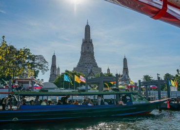 Boat Passing Wat Arun on the Bangkok Riverside Attractions