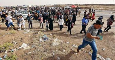 LLL-Live Let Live- ISIS terrorists try to run from the battlefield with civilians fleeing in the besieged Mosul