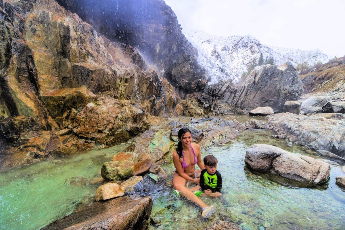 Mother and child sitting in natural hot spring in Idaho
