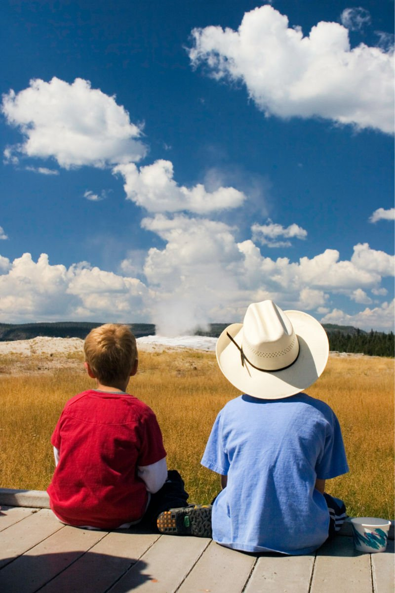 boys looking out at exploding geysers
