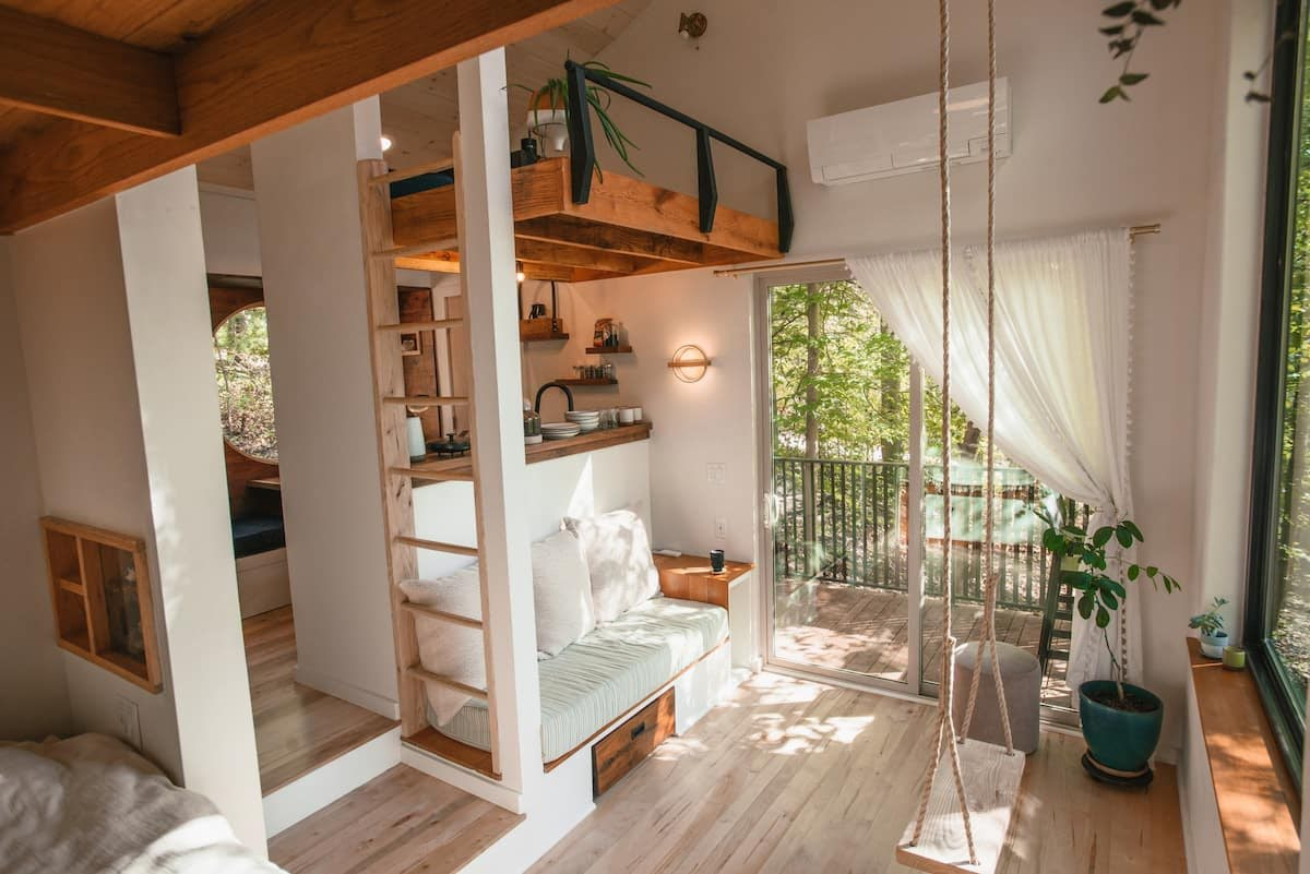 airy lofted cabin with swing in front window