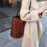 Lovely winter coat and timeless tote winterfashion shopthesalesnow style timelesshellip