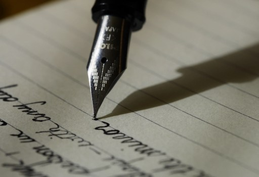CU of fountin pen writing on lined paper