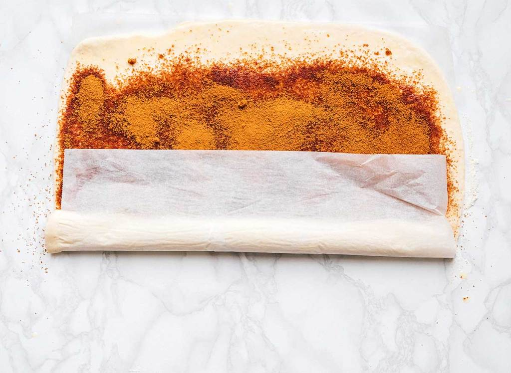 Easy way to roll cinnamon rolls on parchment paper