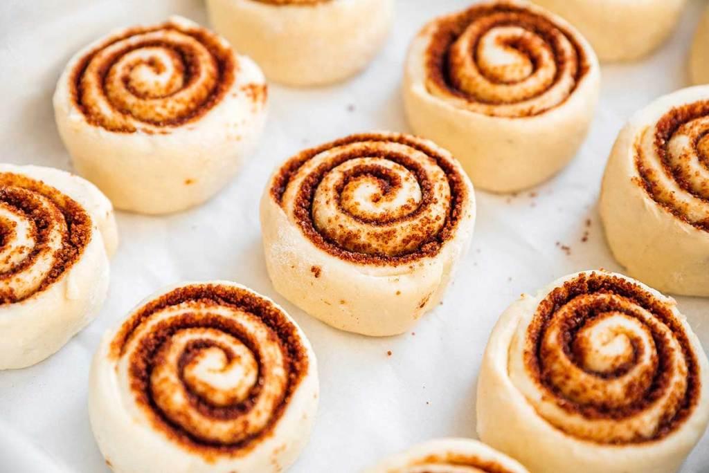 Raw cut cinnamon rolls on marble