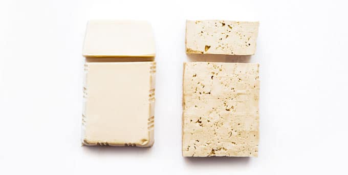 Photo of firm and silken tofu on white background