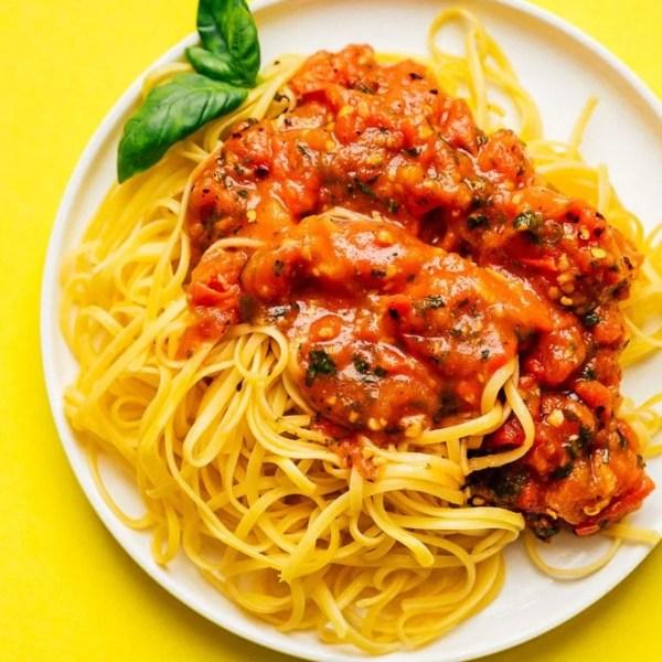 Homemade marinara sauce recipe on a plate of spaghetti