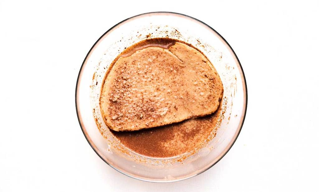 Soaking bread in vegan French toast liquid