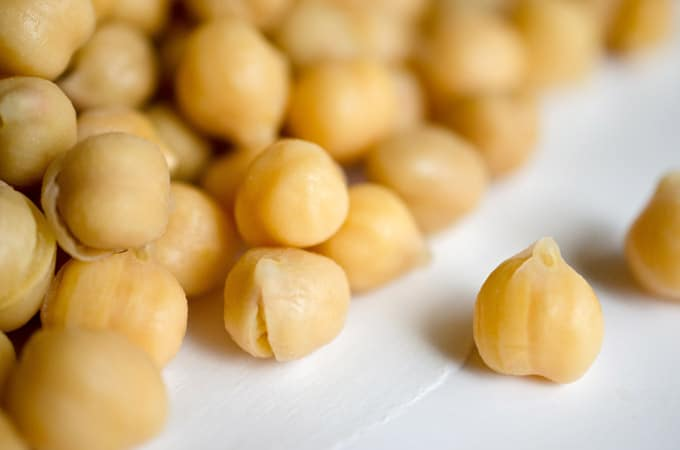 Close up photo of chickpeas - Everything you need to know about chickpeas (or garbanzo beans), including different varieties, uses, and nutrition information.