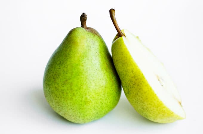 Green pear on a white background