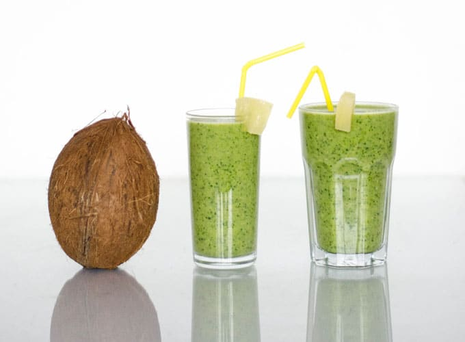 These Tropi-Kale Smoothies are a tropical take on the classic green smoothie, complete with pineapple, coconut milk, and of course, kale!