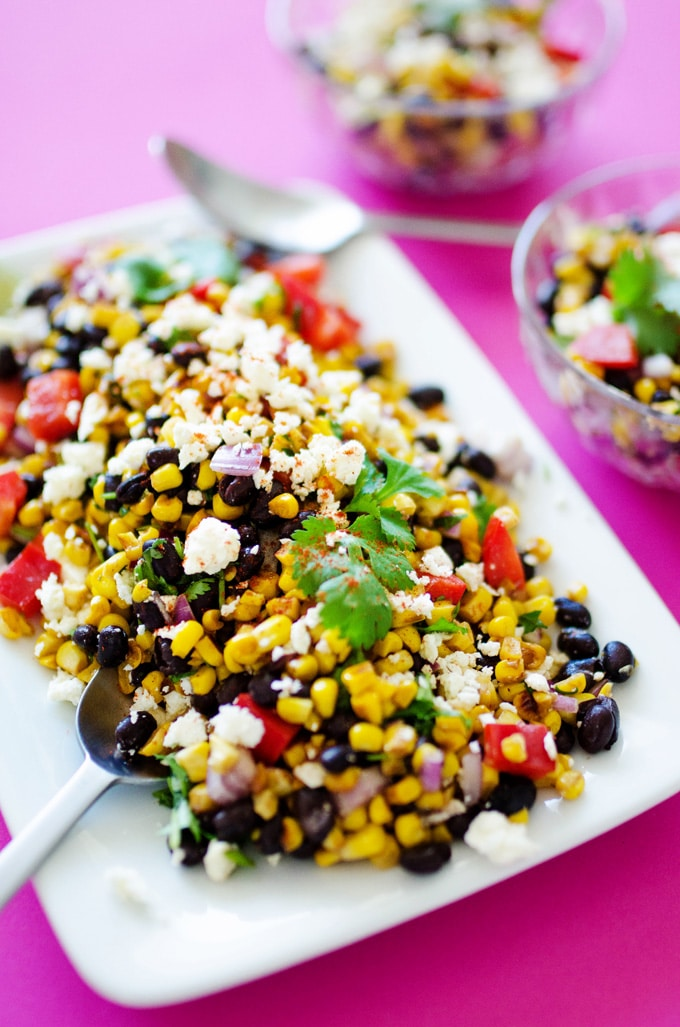 Mexican street corn salad (elote salad) on a plate with dressing