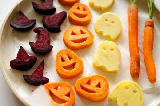 With sweet potato jack-o-lanterns, beet root witch's hats, and spooky potato ghosts, these Halloween Roasted Veggies are a healthy way to celebrate!