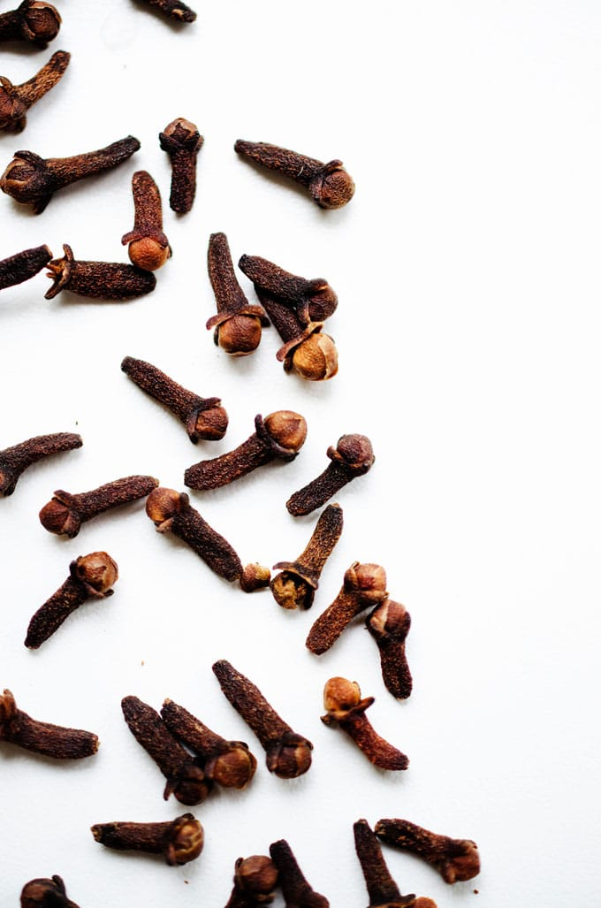 Close up photo of cloves on a white background
