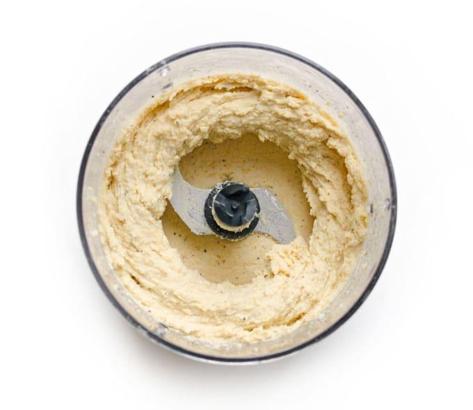 Creamy hummus in food processor