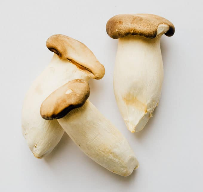 King oyster mushrooms on white paper - Running through the main types of mushrooms and how to use them to add savory, meaty flavor and texture to your vegetarian cooking!