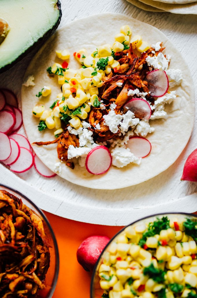These vegetarian tacos are loaded with adobo-spiced pulled mushrooms (which have the same texture and taste as pulled pork) and a fresh corn ceviche that adds sweet crunch. Best vegetarian taco recipe of all time? Quite possibly.