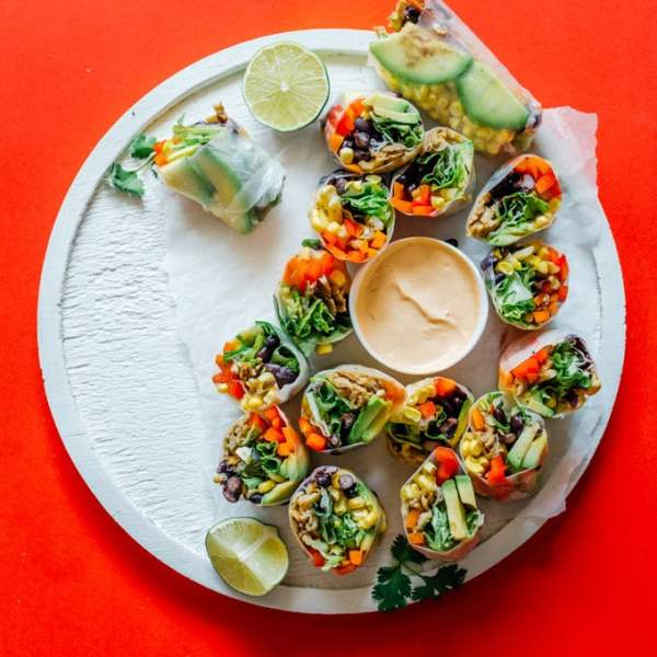These vegetarian Southwest Spring Rolls are packed with fresh vegetables and dipped in a smoky chipotle sauce. You'll forget how healthy they are as you devour the whole pile!