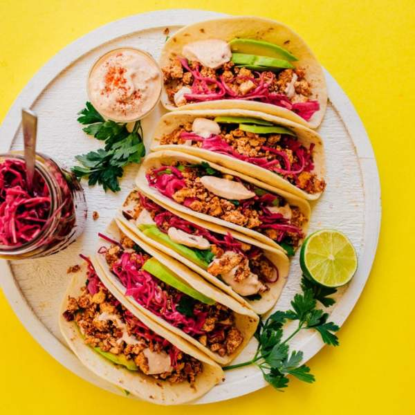 These Soyrizo Tacos are stuffed with homemade vegan chorizo and quick pickled red cabbage, topped off with a smoky adobo crème.