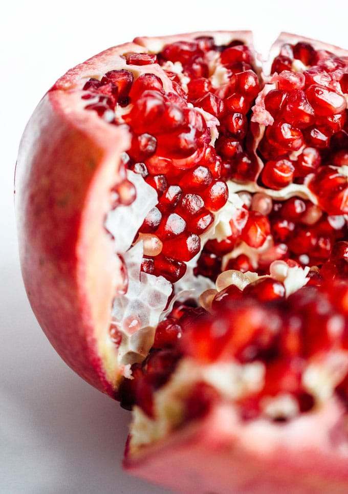 Close up photo of a pomegranate on a white background