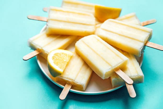 Lemon buttermilk popsicles with ice on a plate