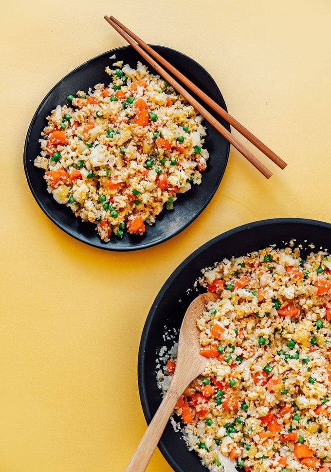How to make low carb cauliflower fried rice recipe on a black plate with chopsticks