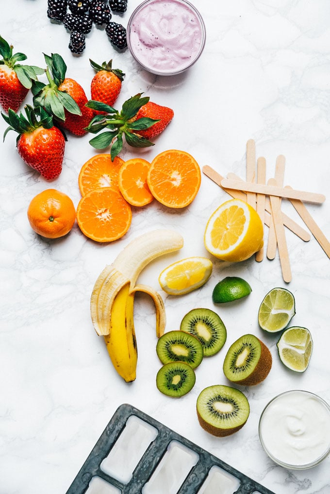 Healthy homemade popsicles recipe photo of ingredients on a marble background