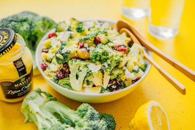 Broccoli salad in a bowl with lemon, feta, an cranberries