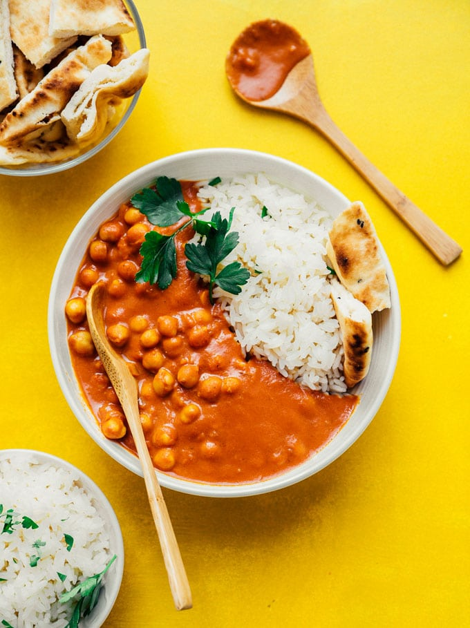 Vegetarian tikka masala with naan and rice in a white bowl