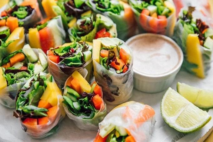Vegetable Vietnamese spring rolls cut in half on a plate