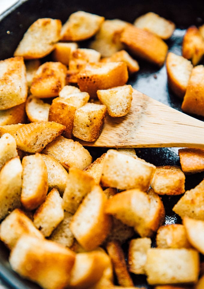 Making homemade croutons in a cast iron skillet