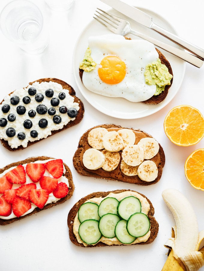 Healthy toast topping ideas on white background