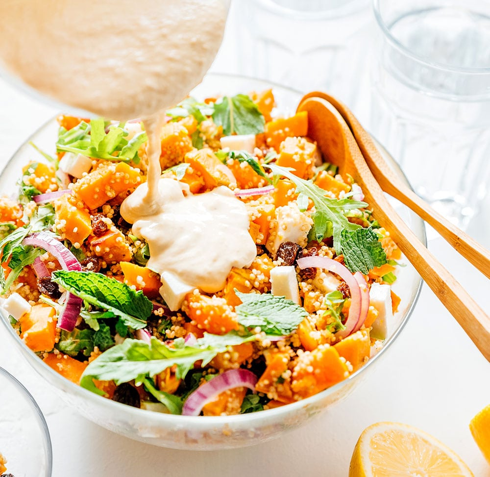 Sweet potato salad in a bowl on a white background