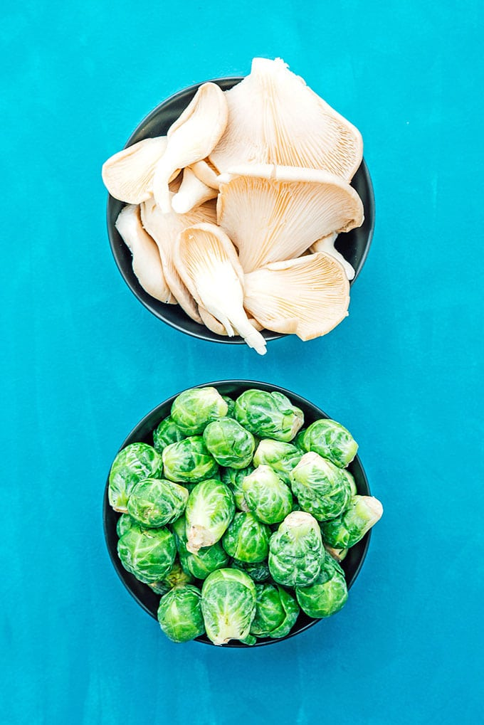 Oyster mushrooms and Brussels sprouts in bowls