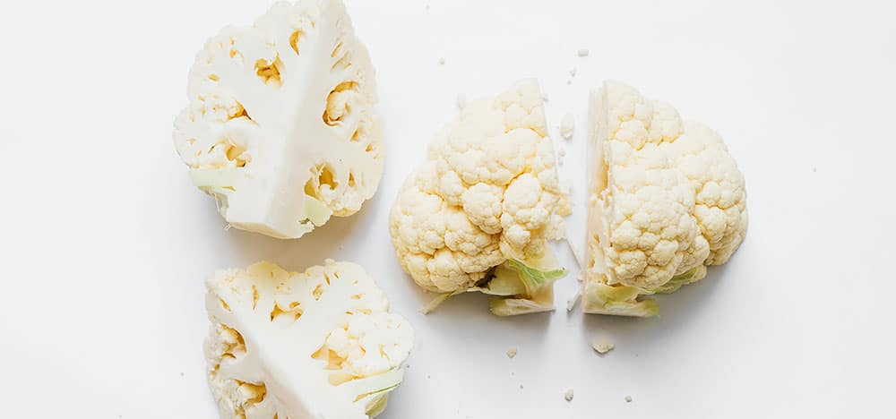 Cauliflower cut in quarters on a white background