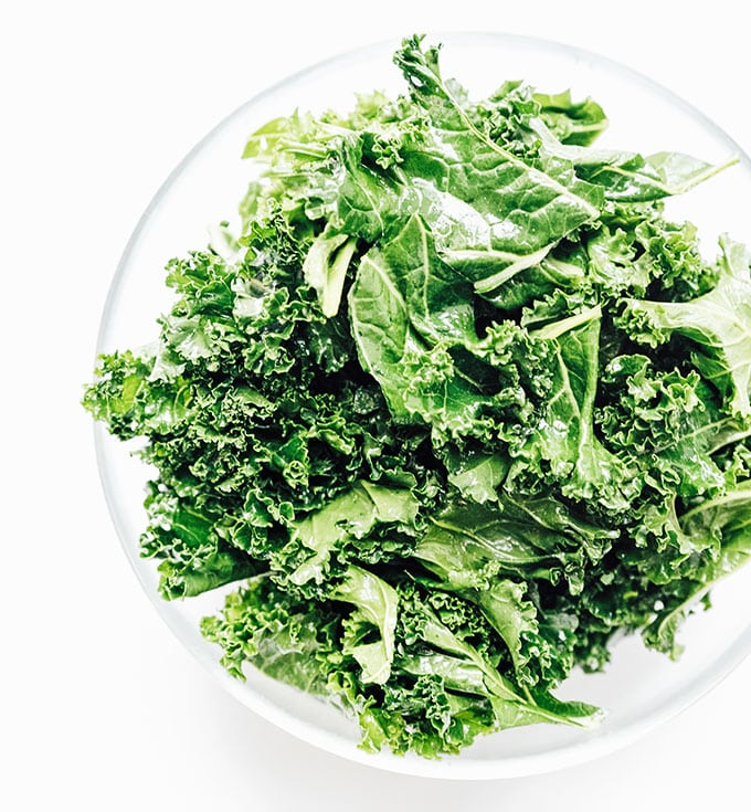Kale in a bowl on a white background