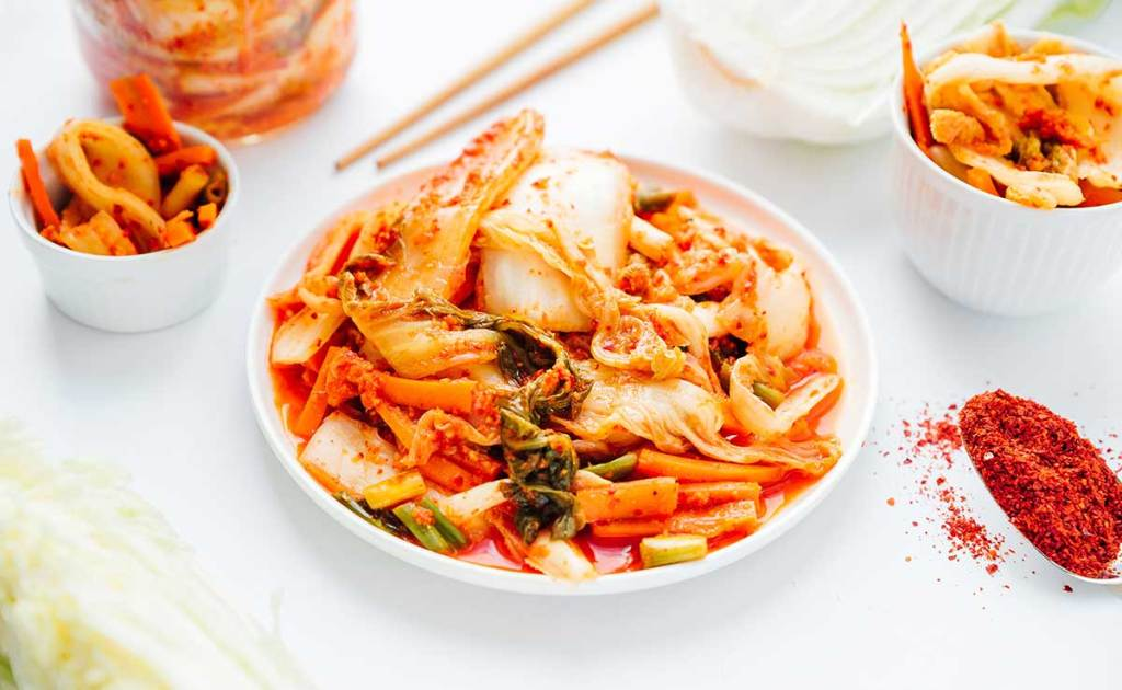 Kimchi on a plate with white background