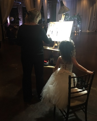 live event painting as child watches