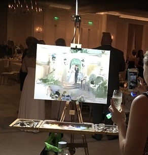 Ann Bailey live event painting of wedding reception while guest photographs the progress