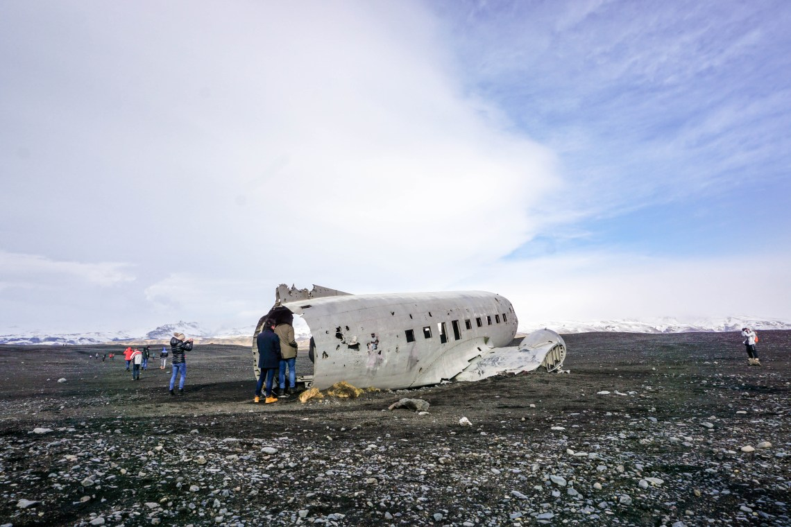 he plane wreck on Solheimasandur black sand beach in South Iceland has become a photographers dream! So glad I got to see it in person, even after the windy 45 minute walk on the beach | Life With a View