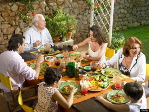 Three generation of a family sharing a meal. Stock photo from Huffington Post